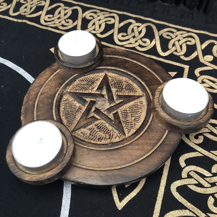 pentagram carved wooden tealight holder.