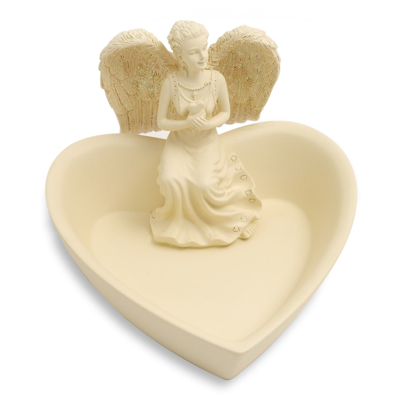 angel sat on heart shaped dish